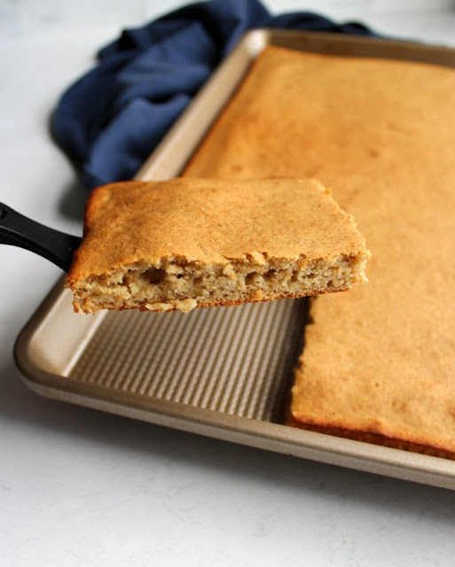 piece of whole wheat banana sheet pan pancake lifted out of pan