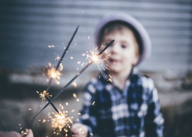 Children playing with fireworks.