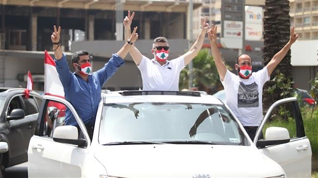 Lebanese protesters return to streets in car convoys amid coronavirus pandemic outbreak