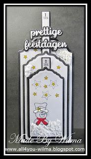 "De kerstlabels/tags waar 1 schuif ""prettige feestdagen"" laat zien. The Christmas labels/tags where 1 slider shows ""Happy Holidays"" (Dutch words)."