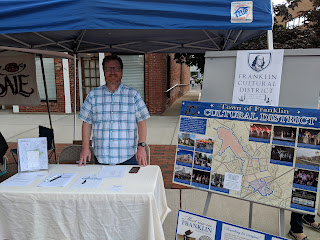 Philip Regan of the Cultural District Committee was at their booth to provide info