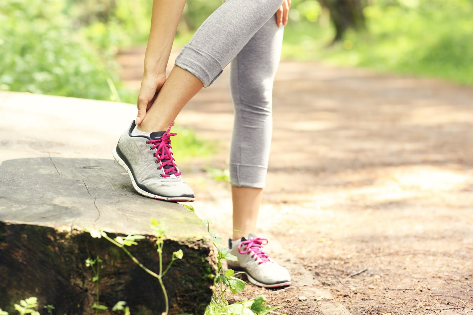 Woman out walking feels pain in her Achilles area.