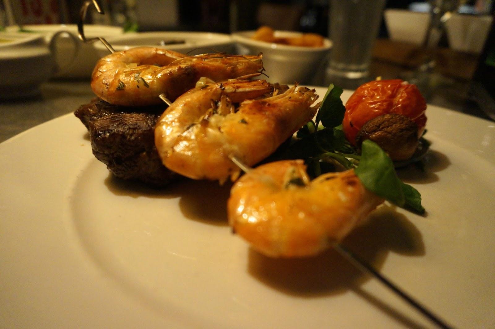 Steak with prawns on stick