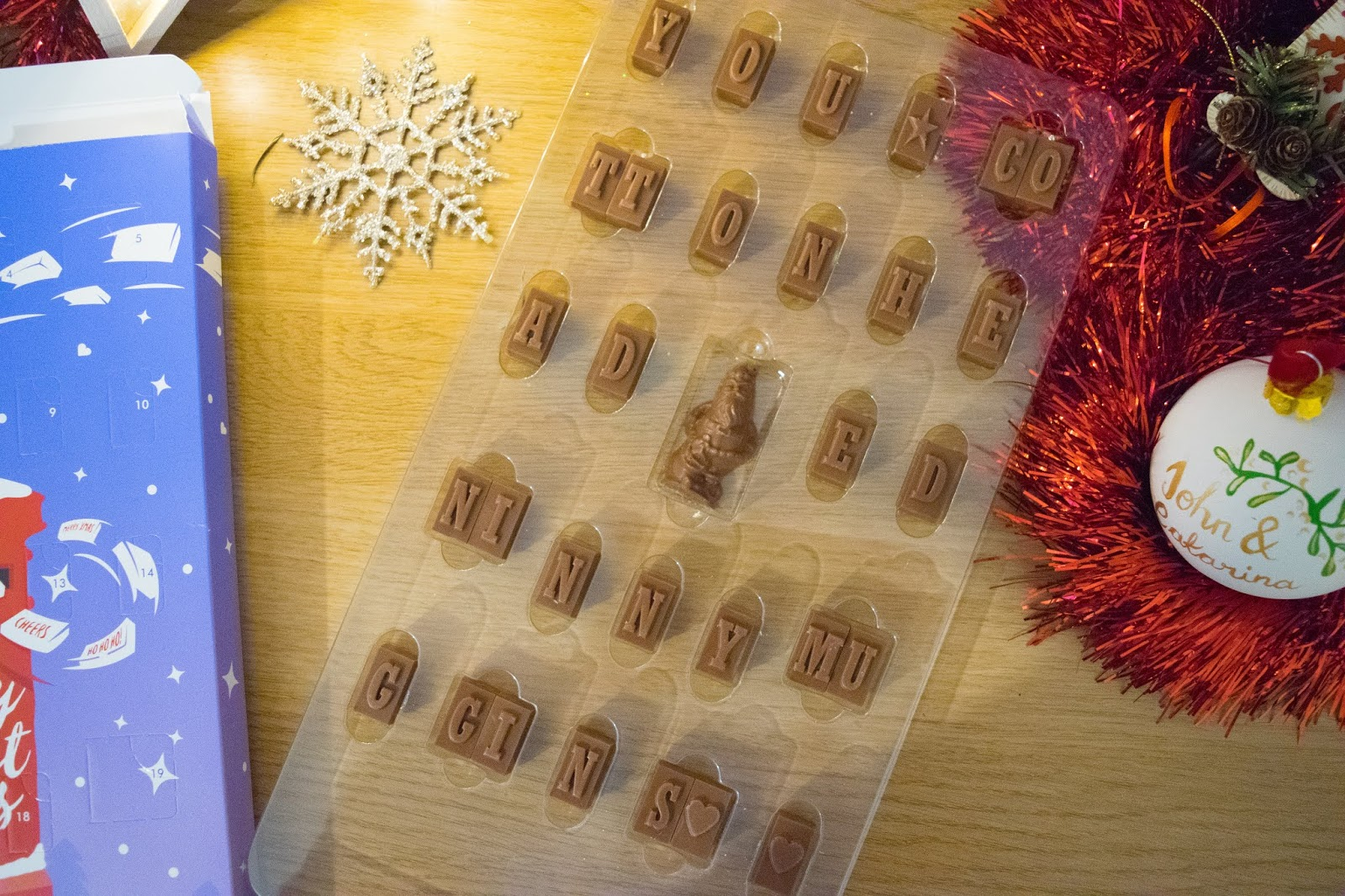 A preview of the chocolate in the plastic tray inside the advent calendar with the personalised secret message: You Cotton-headed Ninny-muggins.