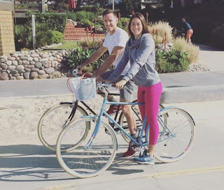 Lilla Frederick & her husband Steve riding in bicycle