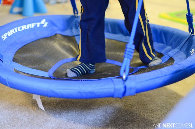Vestibular sensory & gross motor game on a swing for kids from And Next Comes L