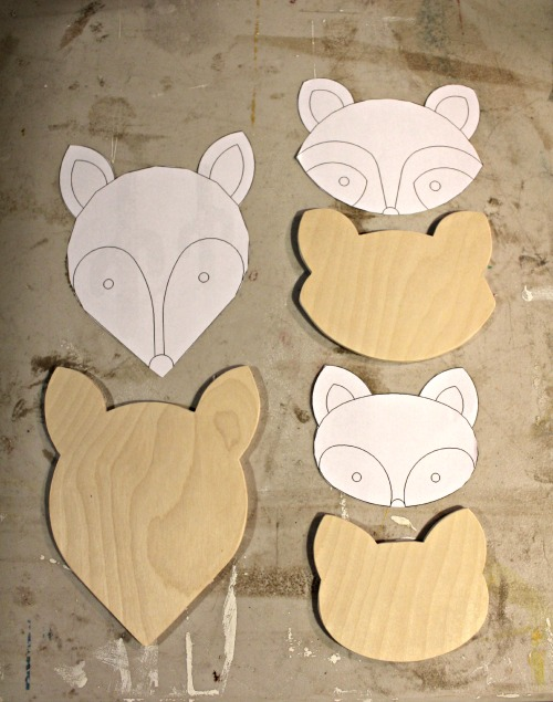 animal faces cut from plywood