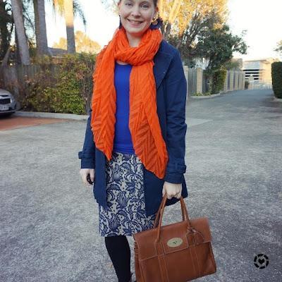 awayfromtheblue instagram | bright winter pencil skirt outfit with orange crinkle scarf