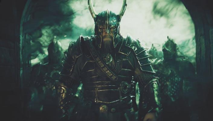 Imagem: uma ilustração do personagem Helm Mão-de-Martelo, um homem branco com uma enorme barba castanha com uma armadura e um elmo de chifres, por trás dois outros soldados e um arco de pedra com um céu verde nevoento.