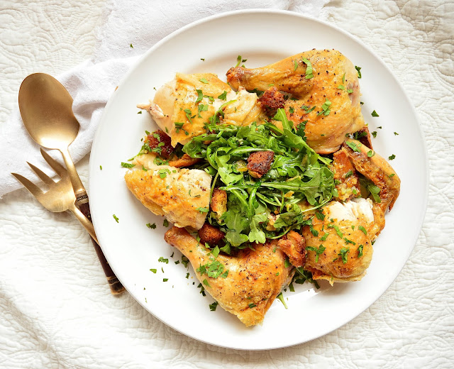This crispy roast chicken is simple and divine. Roasted over artisan bread cubes that become crispy while baking and then tossed with salad, this one dish meal is fabulous!