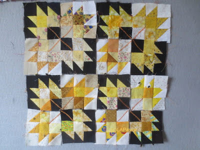 yellow maple leaves on black and cream