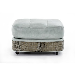 blue leather ottoman with alligator trim and wheels