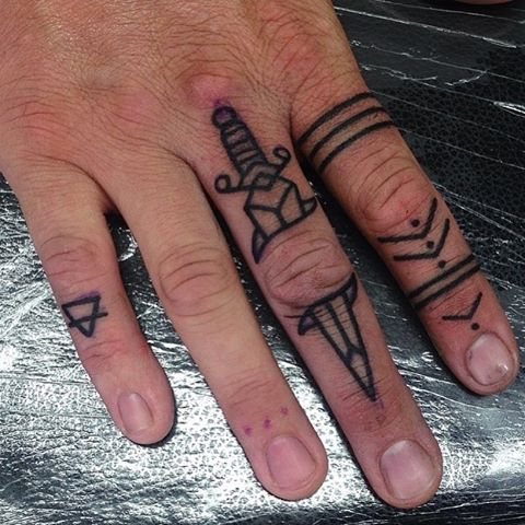 knife tattoo on finger