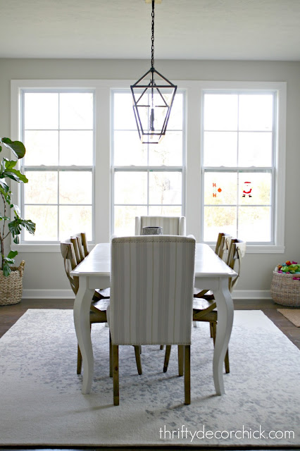 upholstered chairs with rug at end of table