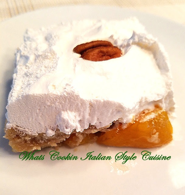 this is a peach dump cake made with cake mix, peaches and topped with whipped cream