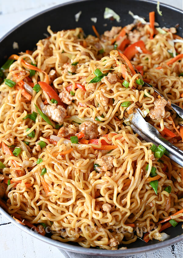 a black pan with best and easy egg roll noodles