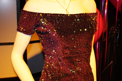 a bardot off the shoulder sequined dress by Motel Rocks on a mannequin at the MotelRocks christmas event