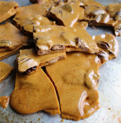 shards of golden pecan brittle on baking sheet