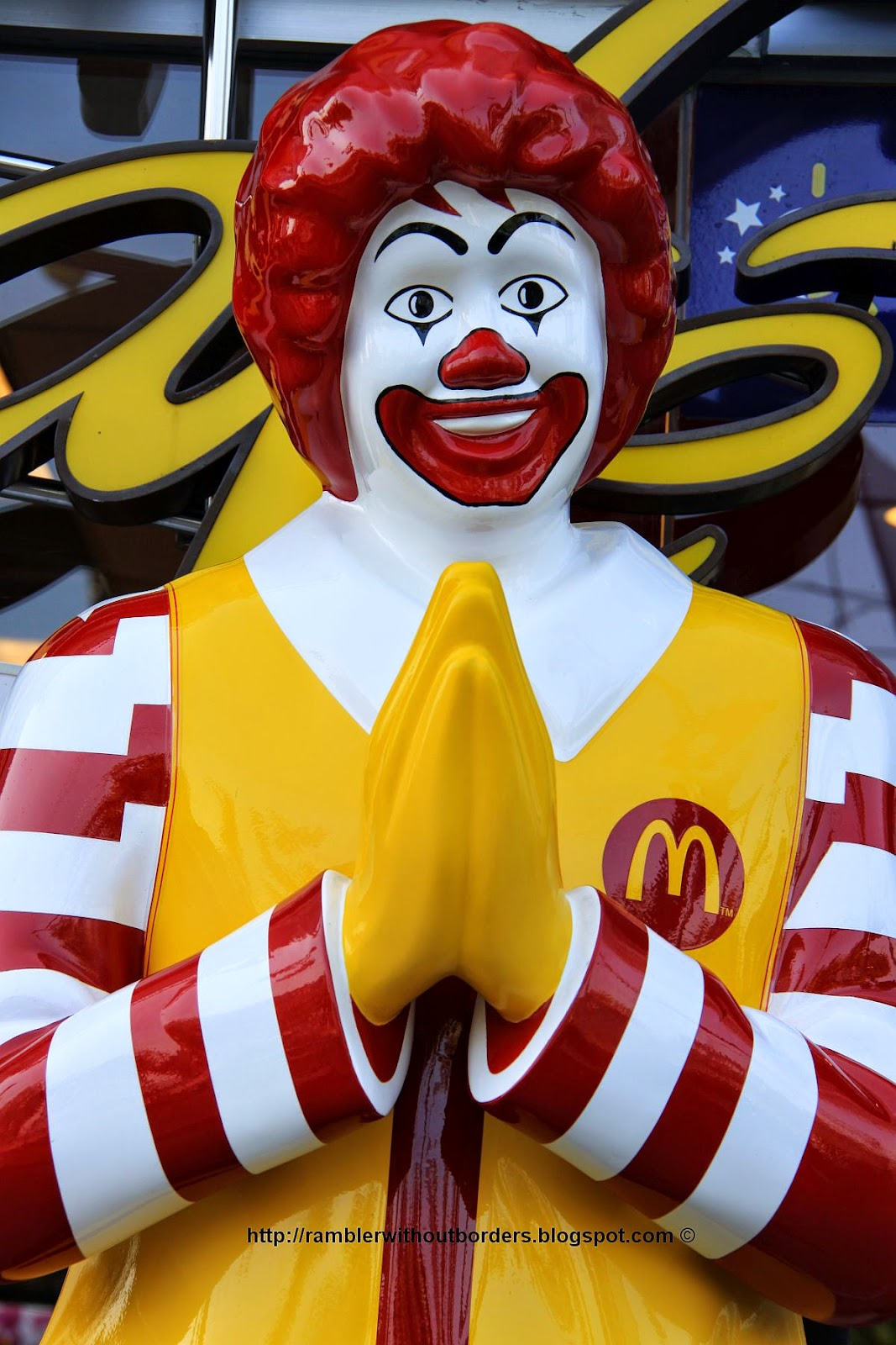 Ronald Mcdonald greets customers with a Thai wai, Thailand
