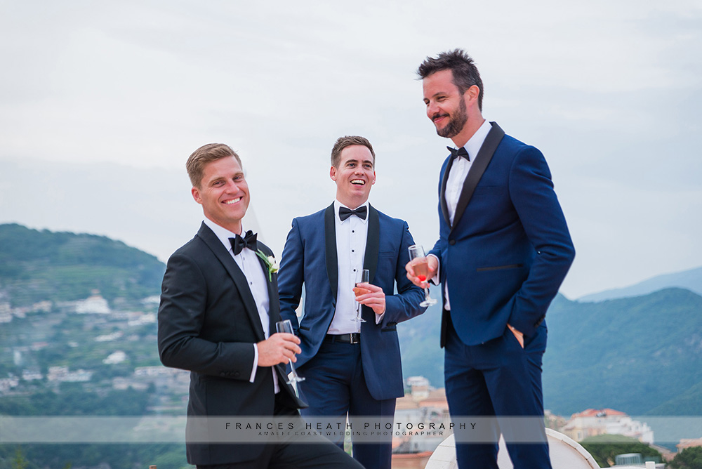 Groom with groomsmen on top of Villa Eva