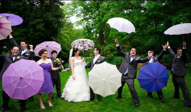 bridal party with umbrellas