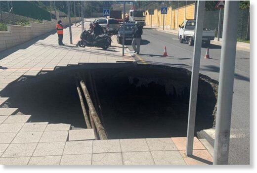 A huge hole formed in one of the streets of Ceuta, Spain