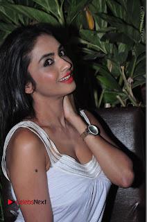 Actress Model Pooja Sri Stills in White Short Dress at F Club pre soft Launch  0086.JPG