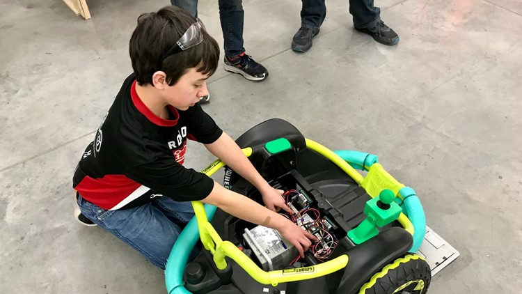 Farmington High School children built a fully functioning personalized wheelchair for a child who could not afford to buy one.
