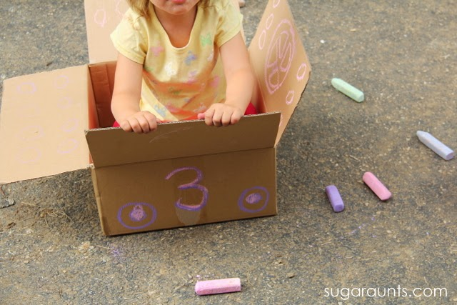 Make a cardboard car for outside fun.