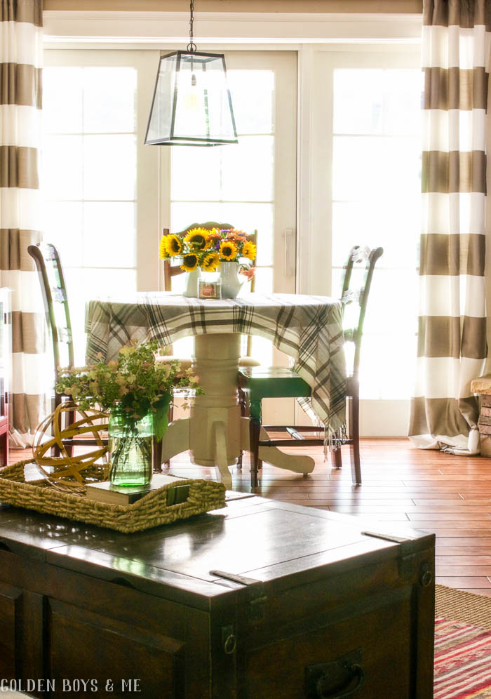Lantern style light fixture from World Market with striped drapes in family room - www.goldenboysandme.com