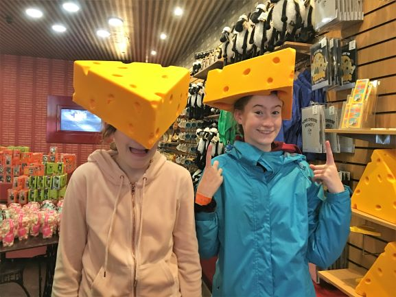 two girls wearing wallace and gromit cheese hats