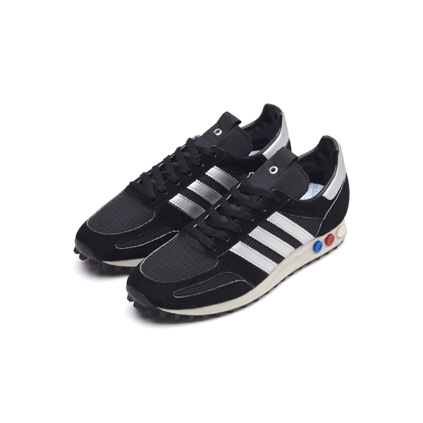 wholesale dealer e53d7 ac1a8 It is a legendary style that effortlessly transitioned from performance to  urban casual. adidas Consortium LA Trainer OG ...