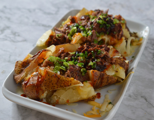 Green chile brisket stuffed potatoes.