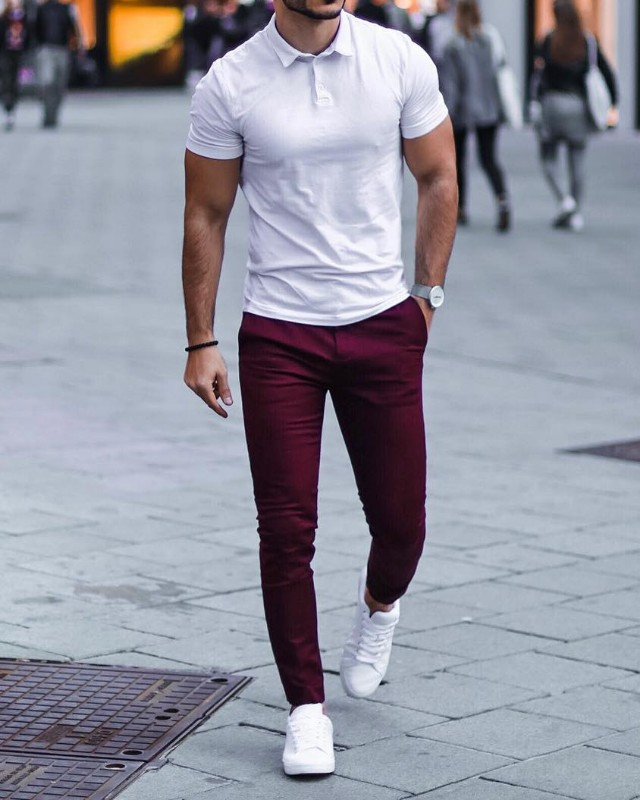 White polo tee and wine colour trousers.