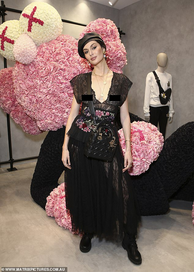 Model Nicole Trunfio dares to bare in a sheer lace frock at a Dior event in Sydney