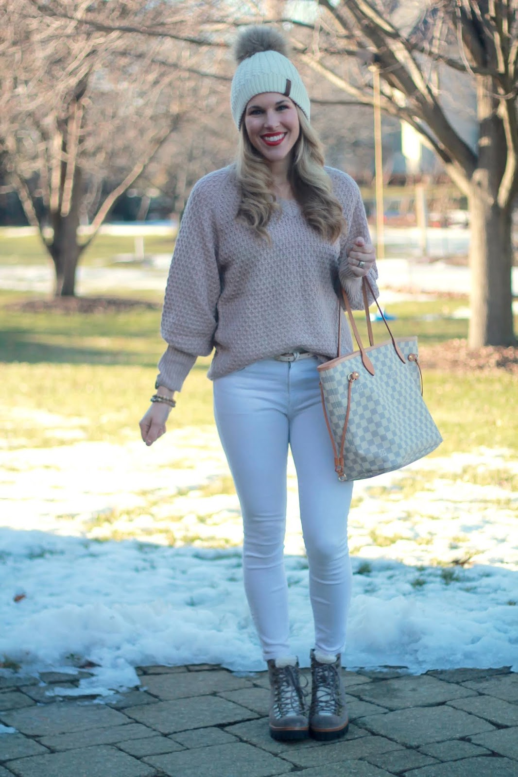 grey v neck bishop sleeve sweater, white jeans, grey combat boots, LV azure neverfull, Starking Watch