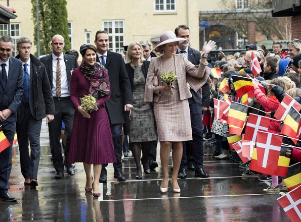 Crown Princess Mary wore Gianvito Rossi pumps, Alexander-McQueen skirt and coat, Prada Brushed Leather Pumps in Dark Red