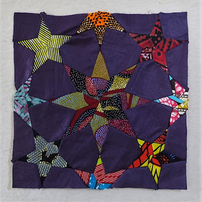 Last stitches to the African Night star quilt
