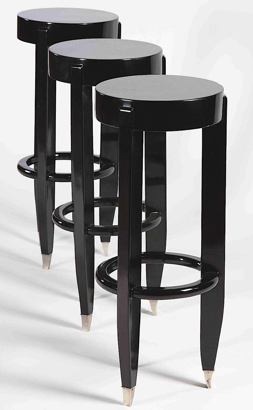 1930 black barstools, a color photograph