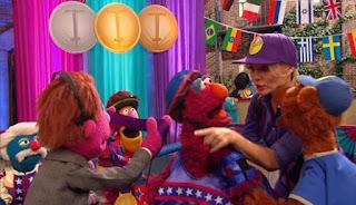 Telly wins the Pogo Gold medal. Baby bear and Gina congratulate him. Sesame Street Episode 4421, The Pogo Games, Season 44.