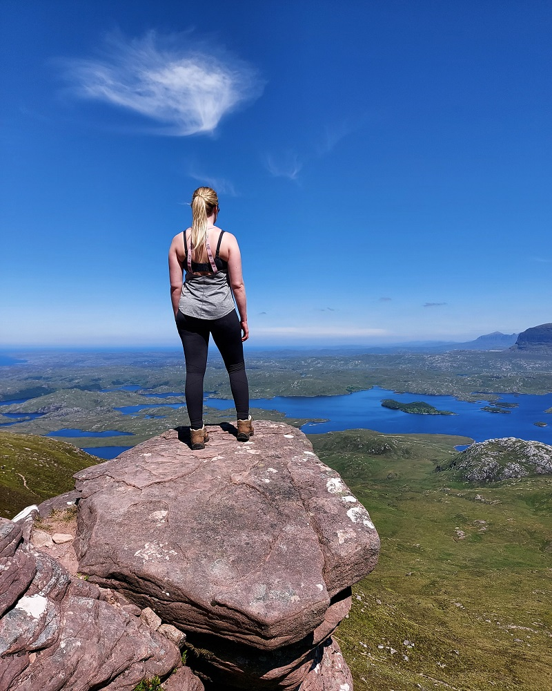 Looking out to the views from a rocky outcrop on Stac Pollaidh