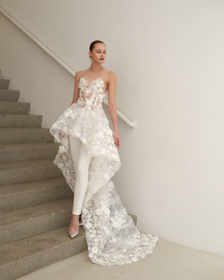 K'Mich Weddings - wedding planning - wedding dresses - white jumpusit with lace overlay and woman standing on the last steps leaning against a rail - francesca miranda