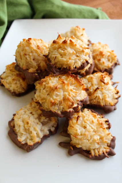 pile of chocolate dipped coconut macaroons on tray
