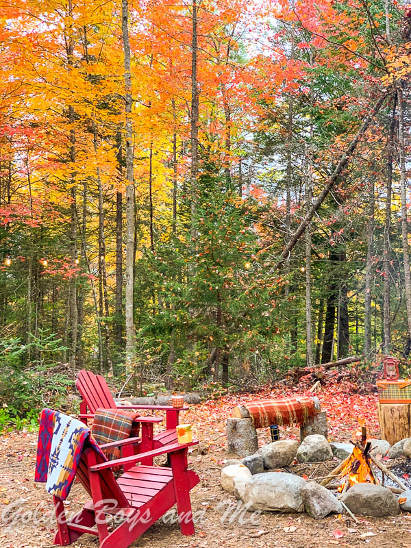 Fire pit by rustic mountain cabin with fall foliage - www.goldenboysandme.com