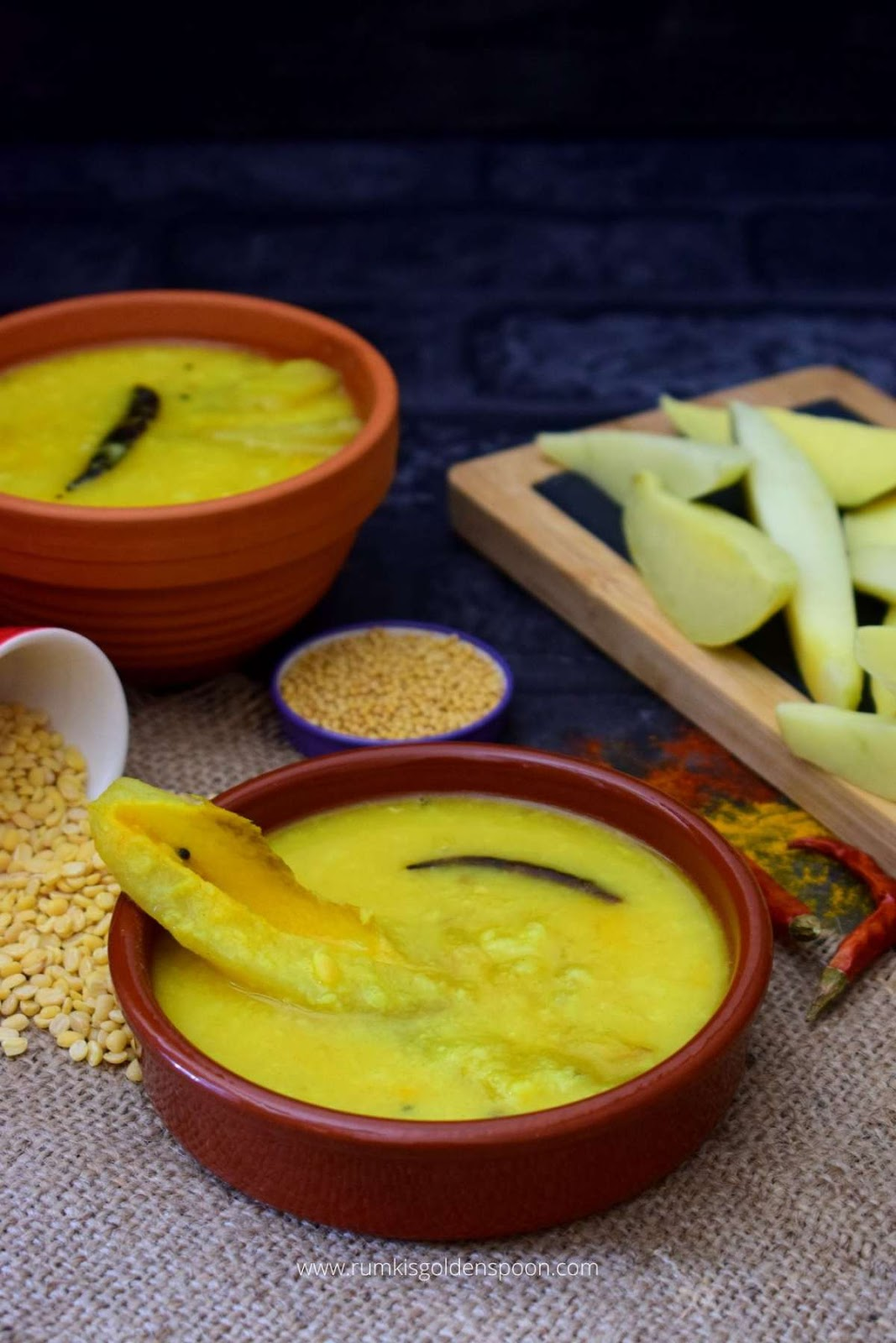 aam dal, aam dal recipe, aam dal Bengali recipe, kacha aam dal recipe, how to make aam dal,aam diye moong dal, tok dal, tok dal recipe, tok dal Bengali recipe, how to make tok dal, aamer tok dal, kacha aam diye tok dal, tok dal kacha aam diye, Bengali tok dal, Bengali aam dal, mango dal, mango dal recipe, how to make mango dal, mango dal Bengali recipe, dal with mango recipe, green mango dal recipe, raw mango dal, raw mango dal recipe, dal with raw mango recipe, dal with raw mango, dal recipe, dal recipes, recipe for dal, bengali recipe, bengali recipes, bengali food, vegetarian recipes of india, vegetarian recipes in India, bengali food recipes, recipes of bengali food, homemade bengali food, traditional bengali food, bengali recipes veg, bengali traditional food, traditional food of Bengali, bengali veg recipe, bengali veg recipes, bengali vegetable recipe, bengali vegetarian recipe, lentil soup, mango lenitil soup, recipe for moong dal, Bengali style aam dal, Rumki's Golden Spoon