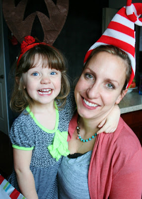 woman and child smiling with holiday headband on