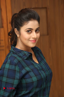 Actress Poorna Stills in Denim Jeans at Jayammu Nischayammu Raa Movie Interview 0008