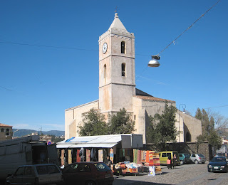 A church and market in Oliena