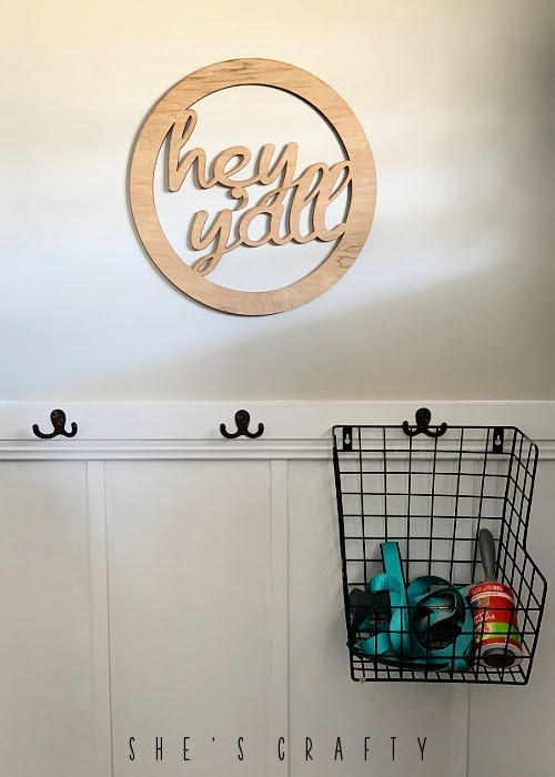 organize dog supplies by containing them in a basket