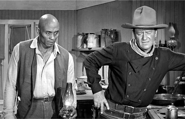 Woody Strode and John Wayne